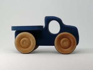 Side view of blue wooden pickup truck toy