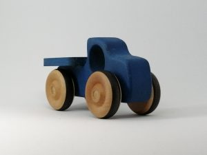 front view of wooden pickup truck in blue
