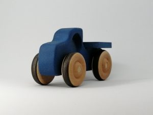 side left view of blue wooden truck toy