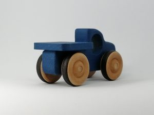 rear view of blue wood toy pickup