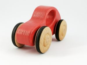 quarter view of red wood toy car gift