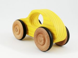 rear quarter view of bright yellow toy car