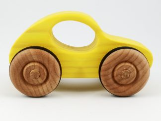 brightly coloured yellow wooden toy car
