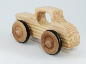 rear side view of wood grain toy car hot rod