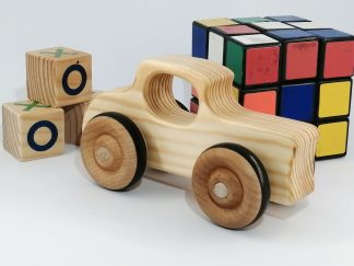 real wood toy hot rod with other toys