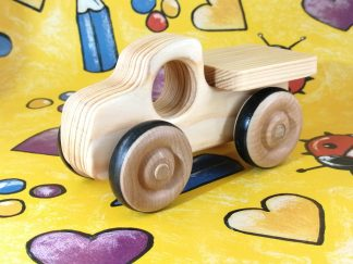 real wood toy truck on gift wrap
