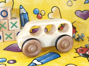 real wood bus toy on gift wrap