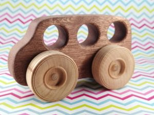 natural wood toy bus on gift wrap