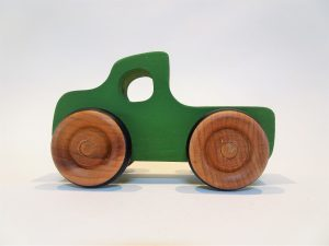 wooden toy truck in green - side view