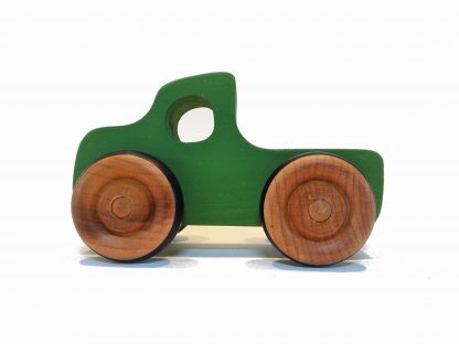 green wooden toy pickup truck