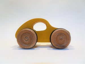 wooden toy car like VW beetle - yellow side view