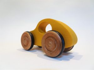 rear view of yellow wooden toy car