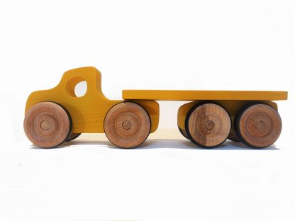 yellow wooden toy lorry