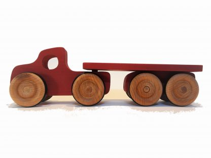 red wooden toy lorry