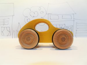 yellow wooden toy car - side