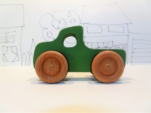 toy wood truck in green - side view