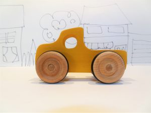 yellow toy wooden truck - side