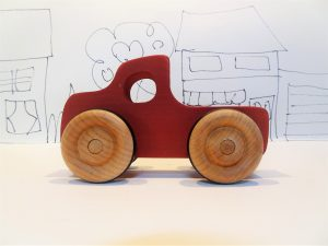 toy wooden pickup truck in red - side