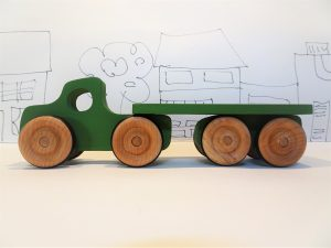 toy green wooden lorry - side