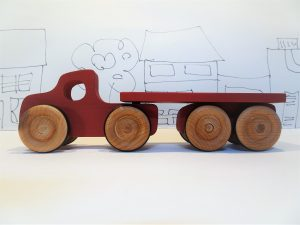 red wooden toy lorry and trailer - side